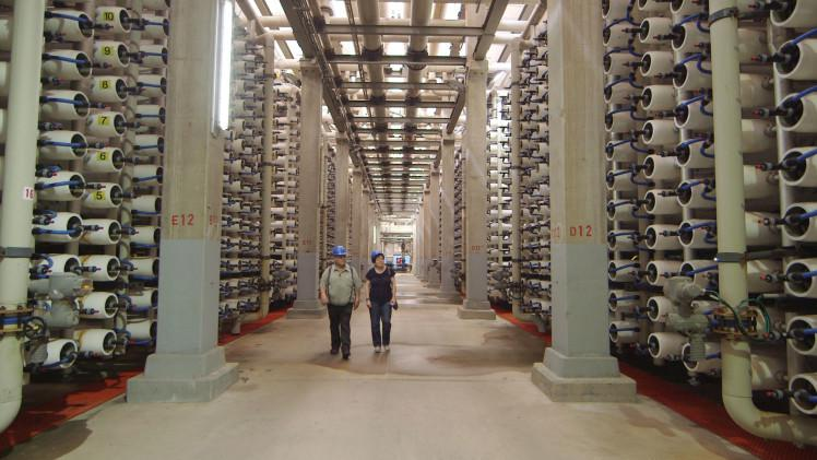 Abraham Tenne, retired head of desalination for the Israel Water Authority, and Professor Sharon Megdal at the Hadera Desalination Plant.